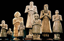 Worshipper statues