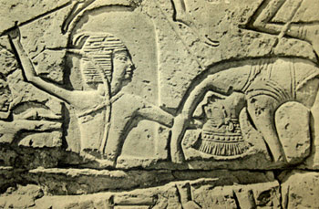 Egyptian warrior killing a Philistine - stone relief